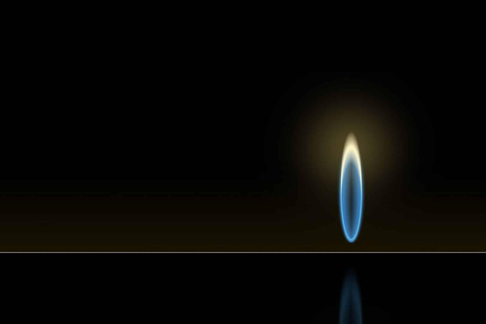 petite flamme de gaz sur fond noir